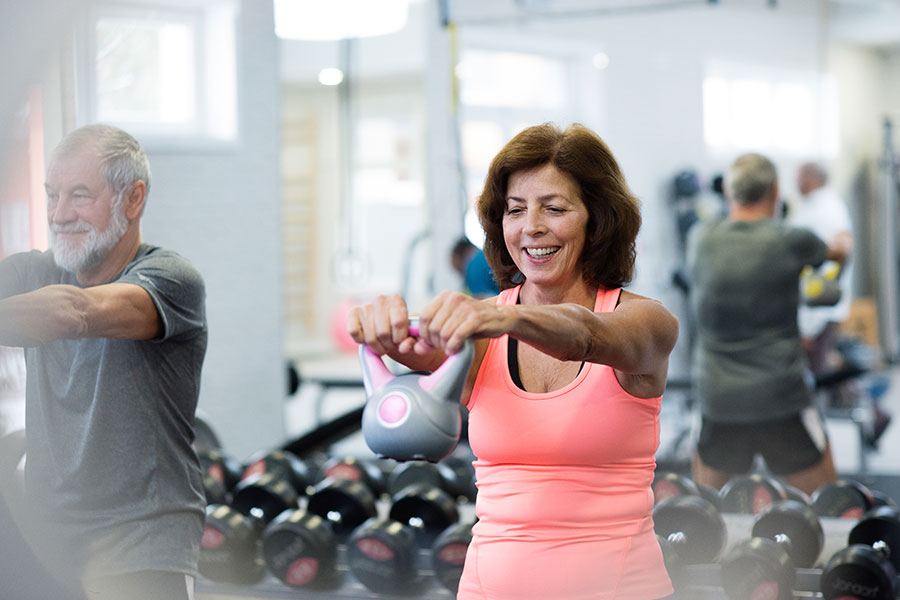 mature woman exercising at the gym