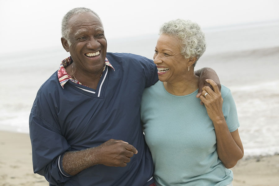 cheerful-african-american-mature-couple-at-the-beach